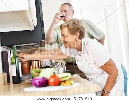 seniors cooking in kitchen at home