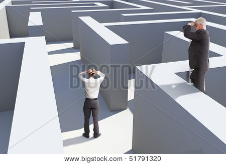 Two businessmen standing in maze being captured