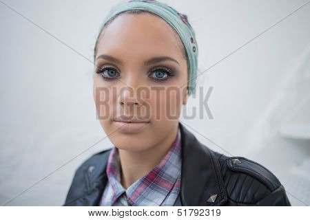 Close up of attractive woman with hairband looking at camera