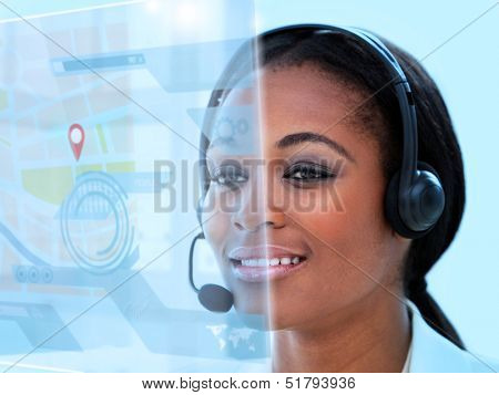 Beautiful call center worker using futuristic holographic interface while on a call in the office