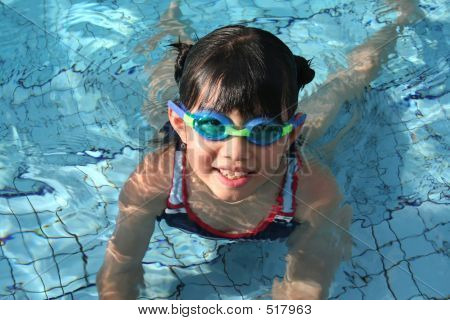 Girl With Goggles In The Pool