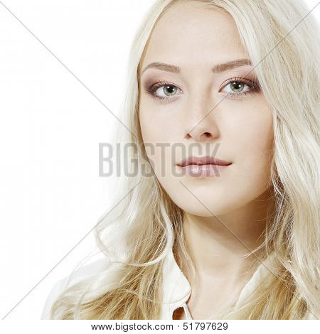 Beautiful blond young woman looking at camera. Isolated on white background