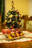 picture of tangerine-tree  - Small Christmas tree with decorations gifts and citrus on the table - JPG