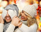 christmas, x-mas, winter, happiness concept - family couple in a winter clothes