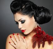 stock photo of nail-design  - Fashion young woman with red nails creative hairstyle and makeup  - JPG