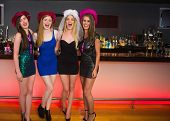 stock photo of hen party  - Laughing friends having a hen party and looking at camera - JPG