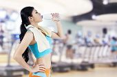 image of health center  - Woman drinking water from a bottle - JPG