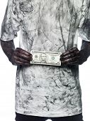 pic of doughy  - Very dirty person holding a five dollar bank note - JPG