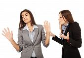 pic of argument  - Portrait of two businesswomen having an argument isolated on white background - JPG