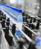 stock photo of reuse  - Close up of bottle industry - JPG