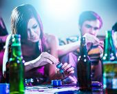 foto of teen smoking  - drug using teens at house party - JPG