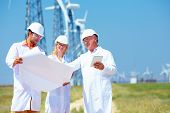 Scientists Discussing Project On Wind Power Station