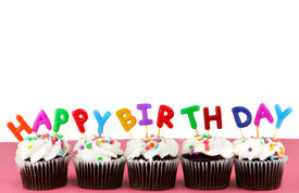 stock photo of happy birthday  - Cupcakes in a row with Happy Birthday candles on top - JPG
