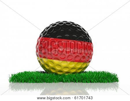 Golf ball with flag of Germany on green grass
