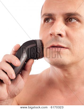 Young Man Using An Electric Shaver, Isolated On White Background