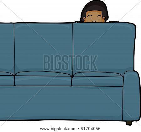 Kid Peeking From Behind Sofa