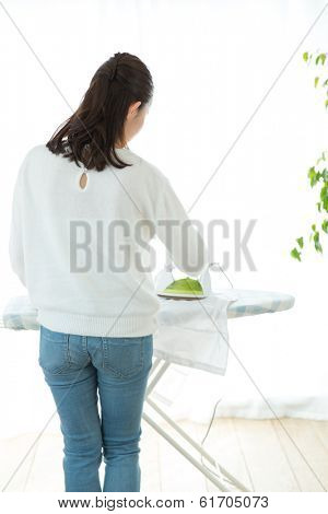 Woman hand ironing a sweater