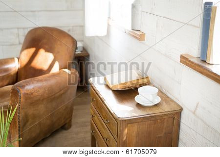 Vintage books and coffee cup on furniture