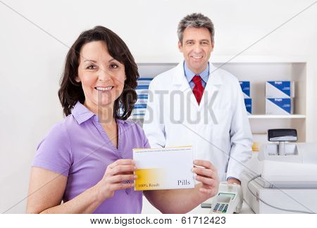 Woman Buying Medicine At Drug Store