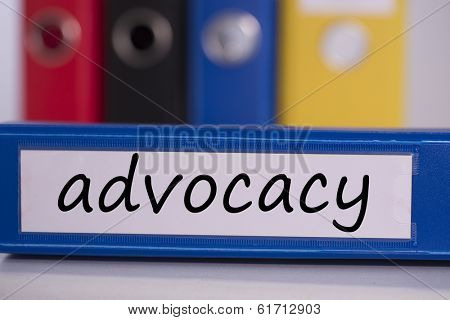 The word advocacy on blue business binder