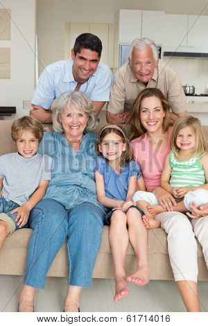 Portrait of happy multigeneration family in sitting room at home