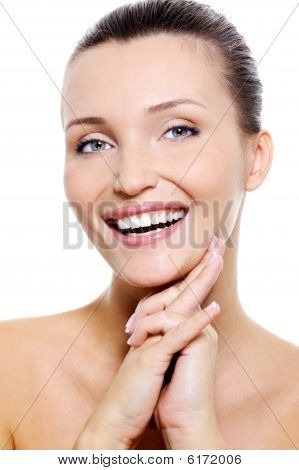 Female Face With The Healthy Withe Smile
