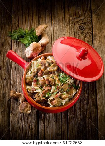 tagliatelle with cep edible mushroom and bacon over casserole