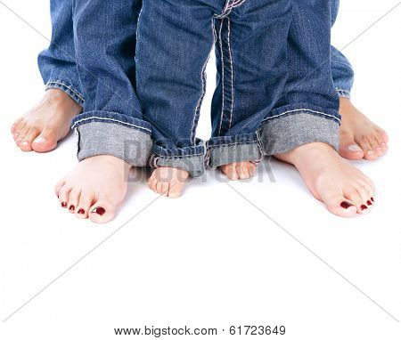 Family unity, abstract border, barefoot people legs isolated on white background, body part, wearing jeans, happy childhood concept