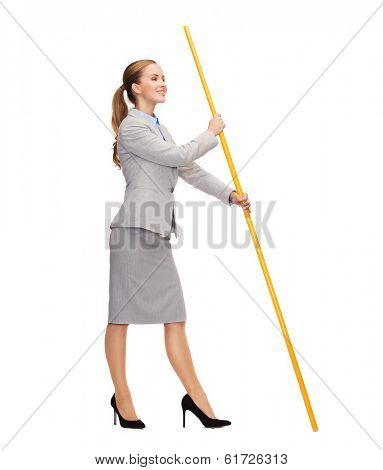 business and advertisement concept - smiling woman holding flagpole with imaginary flag
