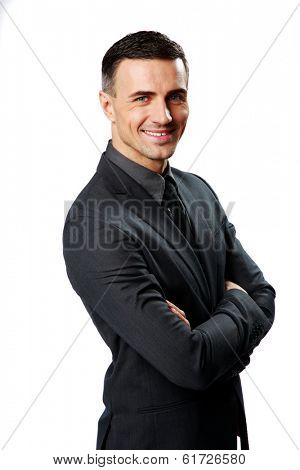Portrait of a smiling businessman with arms folded isolated on a white background