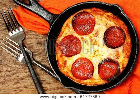 Skillet Peperonni Pizza on Table