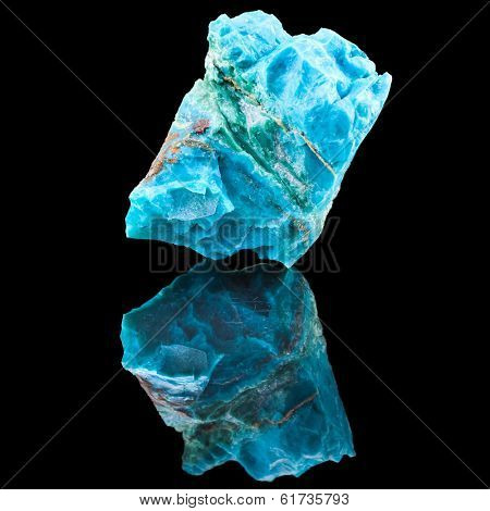 Chrysocolla mineral stone, with reflection on black surface background