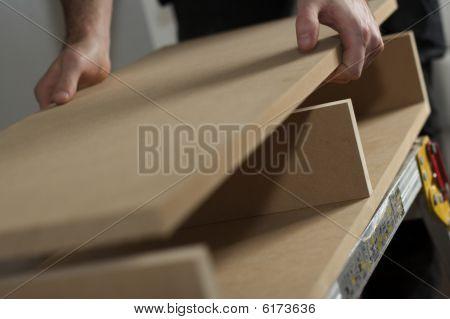 Carpenter Assembling Cabinet  In Workshopp