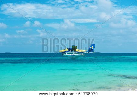 SOUTH ARI ATOLL, MALDIVES - DECEMBER 16 2013: Twin otter seaplane at Maldives