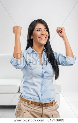Young woman celebrating soccer goal