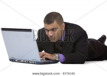 Businessman Works On Laptop