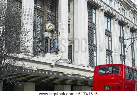 LONDON, UK - MARCH 01: Facade of famous department store Selfridges, with statue of angel holding clock. March 01, 2014 in London.