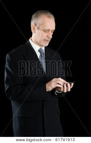 Businessman Writing Sms On Phone