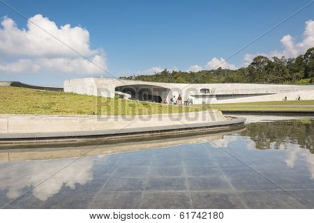 NANTOU, TAIWAN - FEB 20 : Xiangshan Visitor Center scenery with many tourists walk there on February 20, 2014 in Nantou, Taiwan, Asia. The building is famous in Sun Moon Lake park in Nantou, Taiwan.