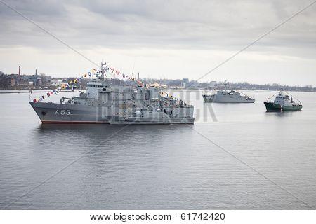 RIGA, LATVIA - NOVEMBER 18 2011:Latvian Naval Forces ships in river Daugava during parade of anniversary of establishment of the Republic of Latvia.