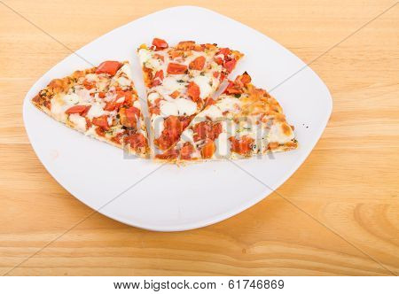 Three Slices Of Tomato Pizza On White Plate