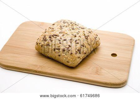 Fresh Baked Grain Bread Roll on Edge Board