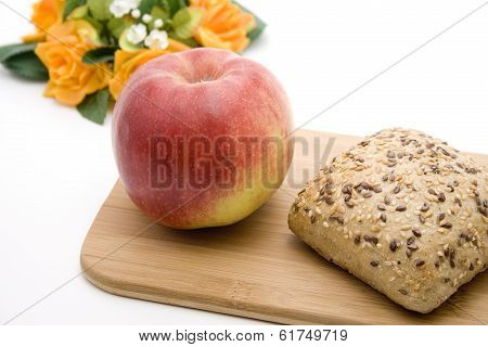 Fresh Red Apple with Baked Grain Bread Roll