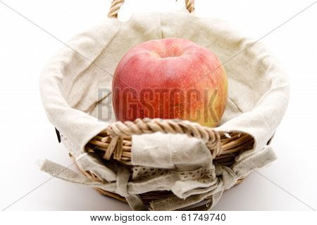 Fresh Red Apple in Basket on white background