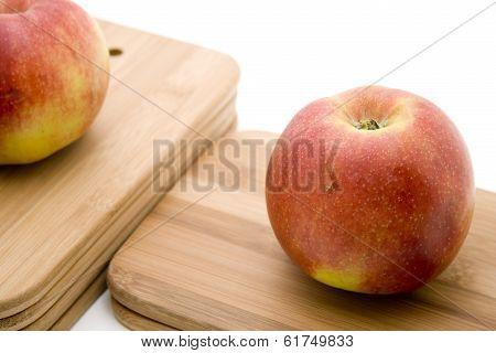Fresh Red Apple on Cutting Board