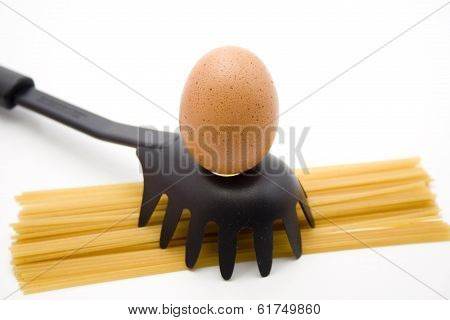 Chickens egg with spaghetti