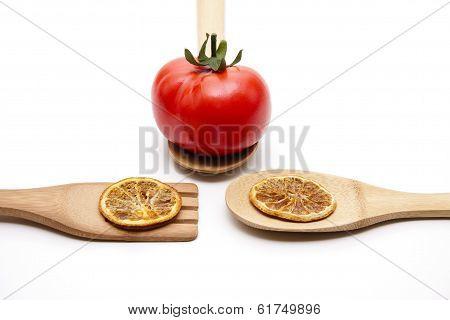 Red Plastic Tomato with Dry Orange Slices