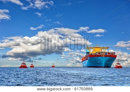 Tugboats And Container Ship
