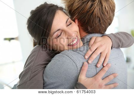Couple embracing, happy to get back together