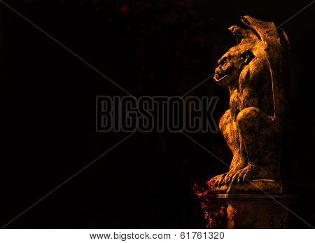 Gargoyle isolated on black background